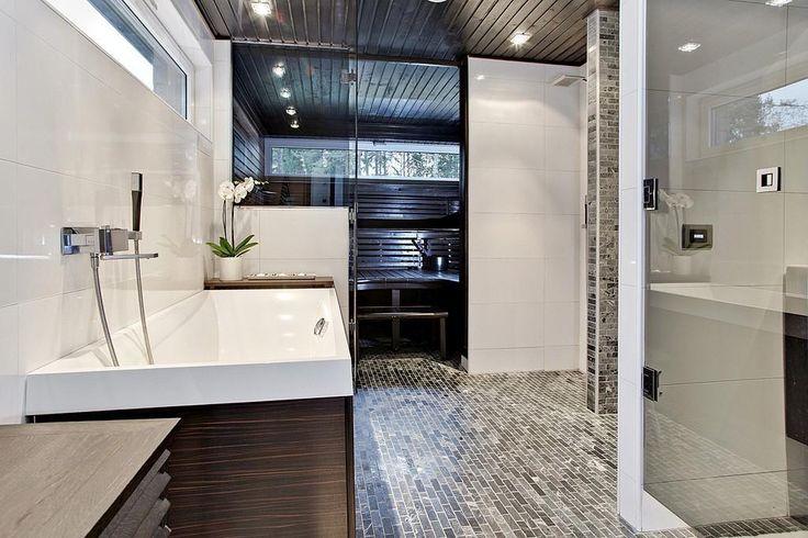 Villeroy & Bochin mallistosta löytyy integroitavia ammeita ja Hansgrohen hana viimeistelee kylpyhuoneen.