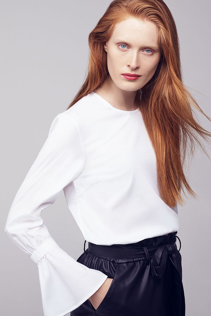 Classic white shirt is a must have for this Autumn. We just love the statement sleeves in this Selected shirt.