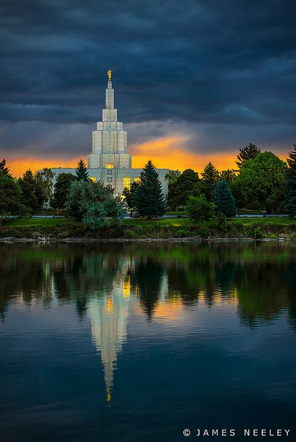 The Idaho Falls LDS Temple reflects in the still water of the Snake River at sunrise on an unusual cloudy summer morning.  - photo by James Neeley, via Flickr