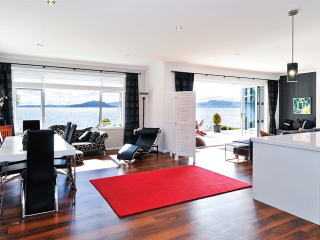 Open plan living offers lake views from every angle.