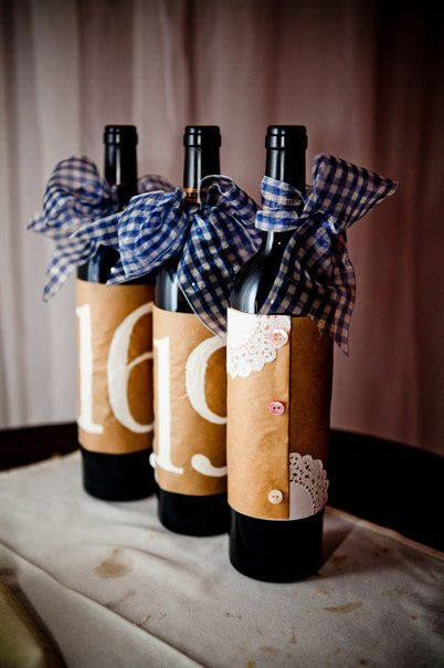 Wine Bottle Table Numbers...not loving the ribbon but I like the big numbers & wrapping paper around the bottles