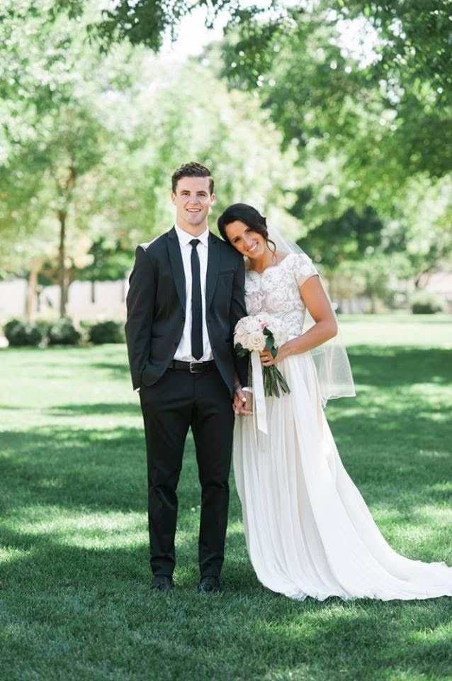 modest wedding dress with cap sleeves and a soft skirt from alta moda. -- (modest bridal gown) --