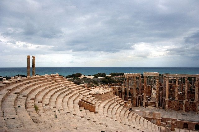 Theatre, Leptis Magna, Libya.    The theatre in Leptis Magna is a typical Augustan age theatre, built in AD 1-2, and subsequently renovated by Caracalla. The scaenae frons (back scene) of the theatre is particularly well preserved.