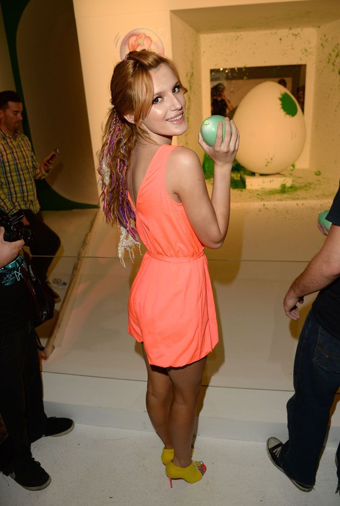 Belle Thorne helped kickoff the launch party of Nintendo's new Yoshi Island, by throwing paint-bombs to decorate an egg. This girl looks amazing doing anything right?