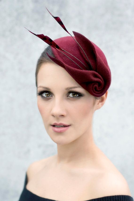 Really awesome Etsy listing at https://www.etsy.com/pt/listing/204416901/cocktail-hat-with-feathers-sculpted-wool