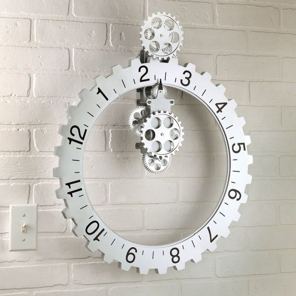 The Hands Free Gear Clock has a large outer sprocket that tells time by way of a tiny arrow at the top of the clock.