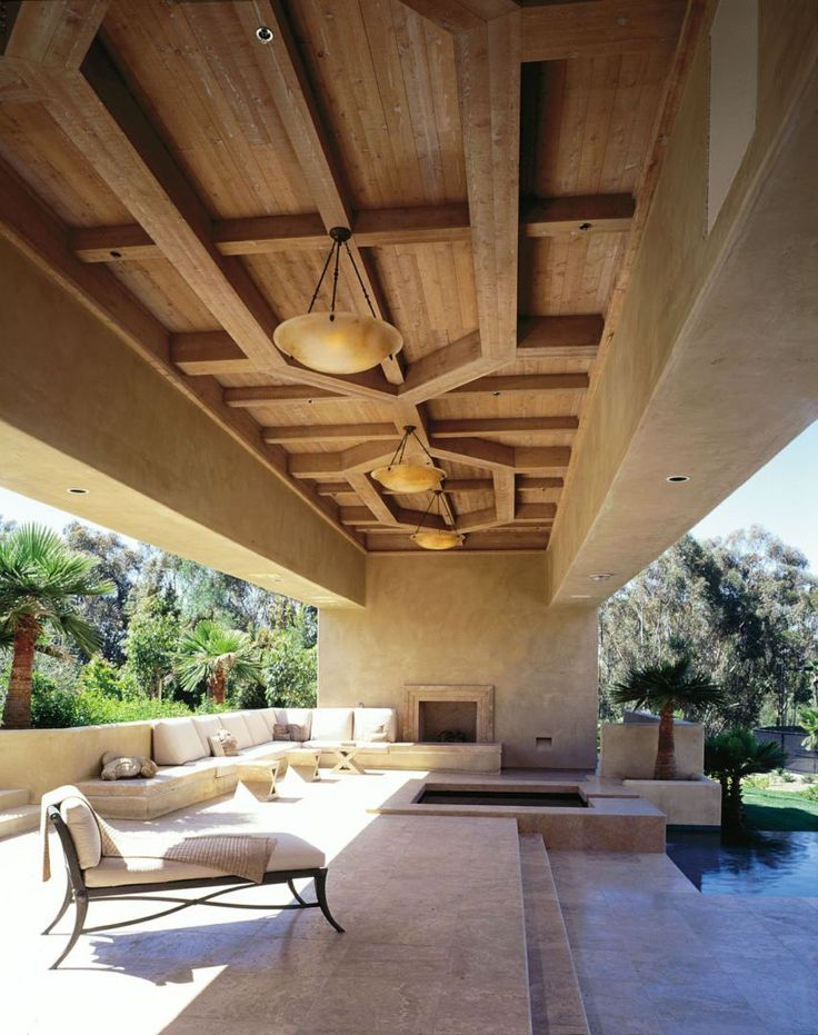 Designed for renowned furniture designer Mike Kreiss, this Rancho Santa Fe estate is a showcase for his art and antiquities collection, as well as his own furniture pieces. Wooden ceilings with Moorish-inspired classical geometric forms lend warmth to the soft contemporary design. The house incorporates sliding glass doors to open the house and enjoy the beautiful weather that is nearly year round.