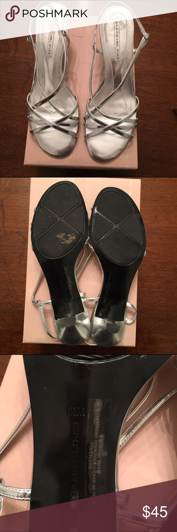 Bandolino silver strappy heels size 8.5 Bandolino silver strappy heels size 8.5. Worn for a total of two hours at a wedding. Heel is about 2 inches. Heel has a few knicks but nothing you can even notice. ( see photos ) They are in practically new condition. Bandolino Shoes Heels