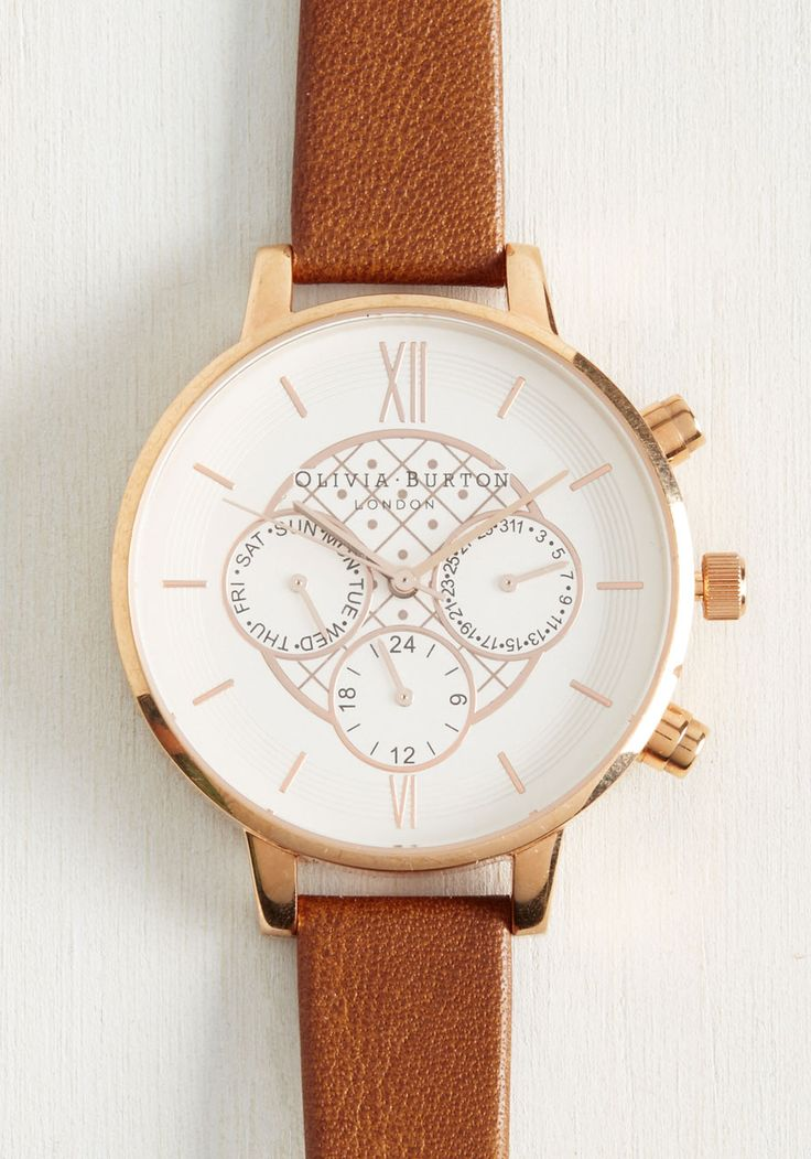 There's no denying you're truly on top of your day with this classy tan leather watch. On the rose gold-framed face of this Olivia Burton Big Dial Chrono Detail style, roman numerals and tick marks keep time, while the smaller scales shine with the day, date, and 24-hour clock.