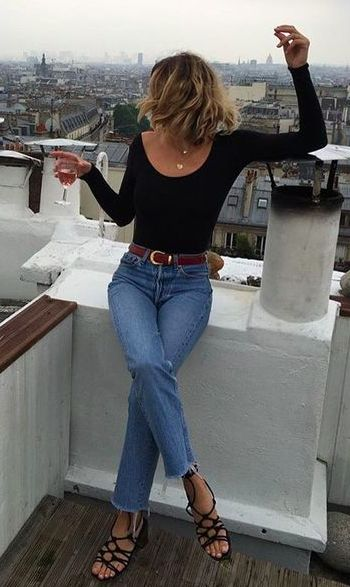 brown belt for keeping her pants up on her tiny waist. also she's two little to be drinking on rooftops - clary