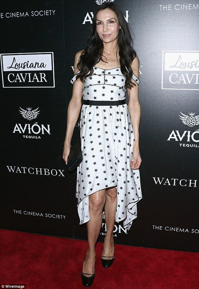 Heavenly! Famke Janssen commanded attention in a flirty white dress scattered with stars  during Monday's screening of her new film Louisiana Caviar in NYC