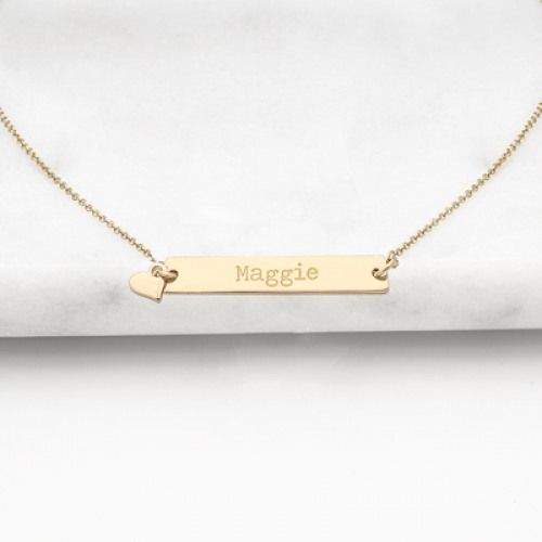 Charm her on the wedding day with this personalized bar necklace with charm.