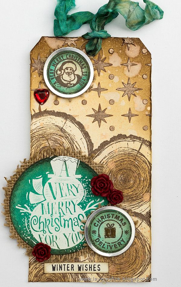 Layers of ink - Snowman Shimmery Tag Tutorial by Anna-Karin. Made with Tim Holtz exclusive Simon Says Stamp STAMPtember holiday stamp and stencil set. Ranger inks, paints and mist.