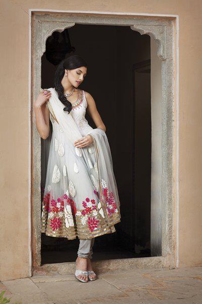 Net kurta with velvet and tissue appliqué work with silk churidar priced at $489.