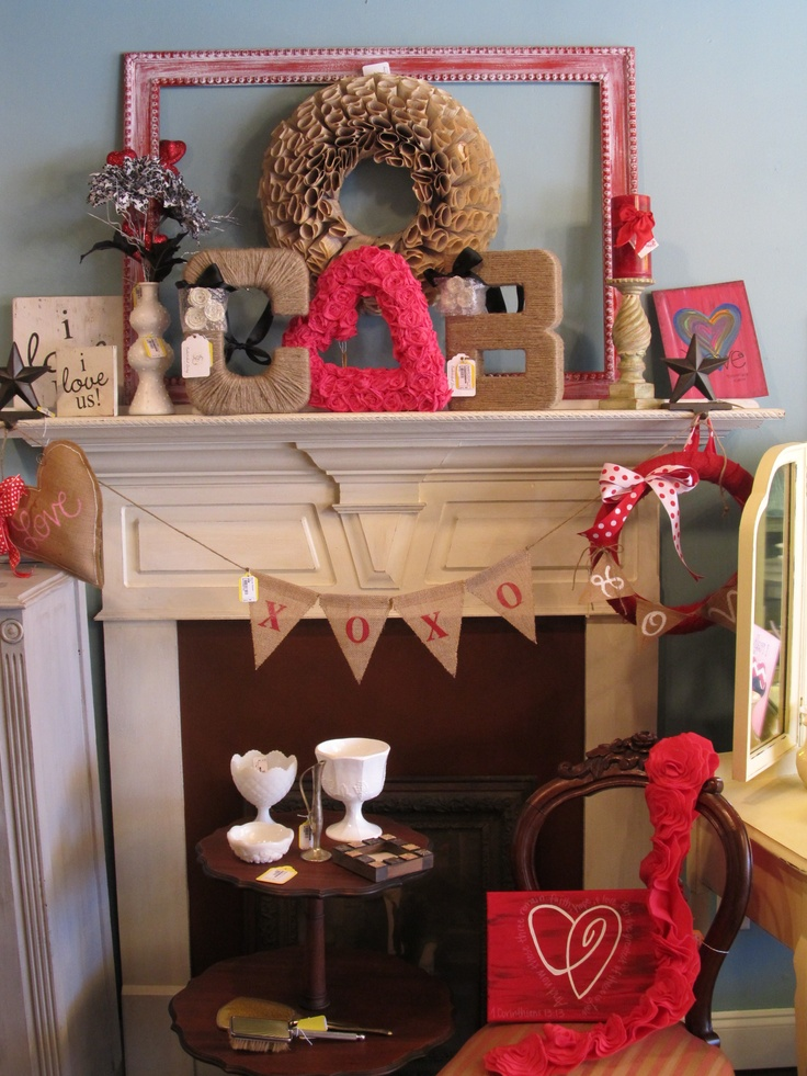 Valentine's Mantle using empty frame, paper book page wreath, crepe paper heart wreath, twine wrapped letters, burlap banner, and rustic I love us signs #ssmarketplacetn