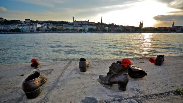 Created by Hungarian sculptor Gyula Pauer and his friend Can Togay in 2005, Shoes on the Danube pays tribute to Hungarian Jews who were killed by the river at the hands of the Arrow Cross Party, one of Hungary's most notorious fascist organizations, in the 1940s. Because shoes were very valuable at the time, victims were asked to remove theirs before execution. Each sculpted pair is modeled after actual shoes of the time.