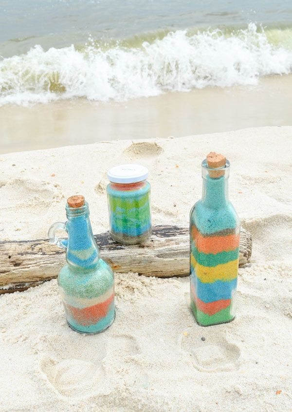 Want a fun beach vacation activity? Color sand and create these sand art bottles using the sand at the beach. It's a perfect family spring break craft.