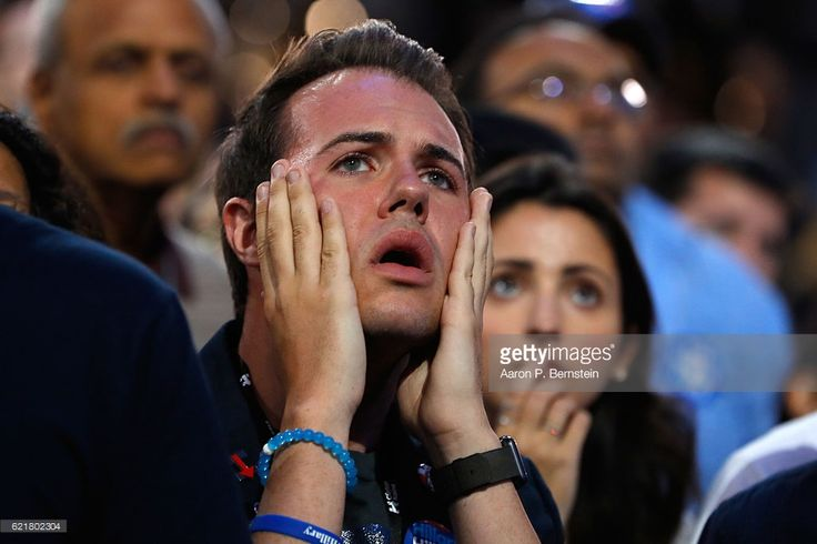 A man reacts as he watches voting results at Democratic presidential nominee former Secretary of State Hillary Clinton's election night event at the Jacob K. Javits Convention Center November 8, 2016 in New York City. Clinton is running against Republican nominee, Donald J. Trump to be the 45th President of the United States.