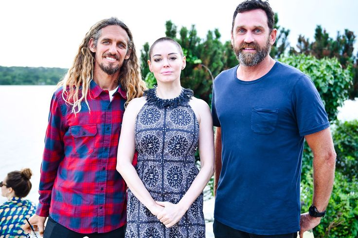 Rob Machado, Rose McGowan, and Taylor Steele at the Montauk Surf Club on July 23. By Griffin Lipson/BFA.com.