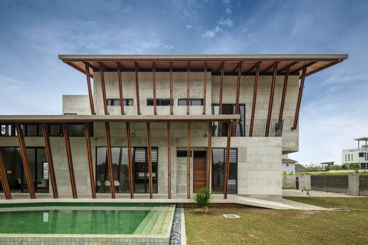 Completed in 2015 in Sepang, Malaysia. Images by Marc Tey. The Sepang House is defined by a large sheltering roof with deep overhangs, shaded terraces and balconies along its edges. It uses raw concrete,...