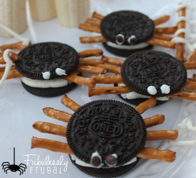 Super fun treat for the Halloween party at school! Oreo Spiders and Chocolate Pretzel Spider Webs! www.Fabulesslyfrugal.com