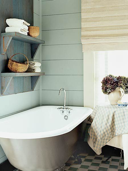 i love all of the colors in this bathroom, the tub, and the antique shelving unit. perfect.