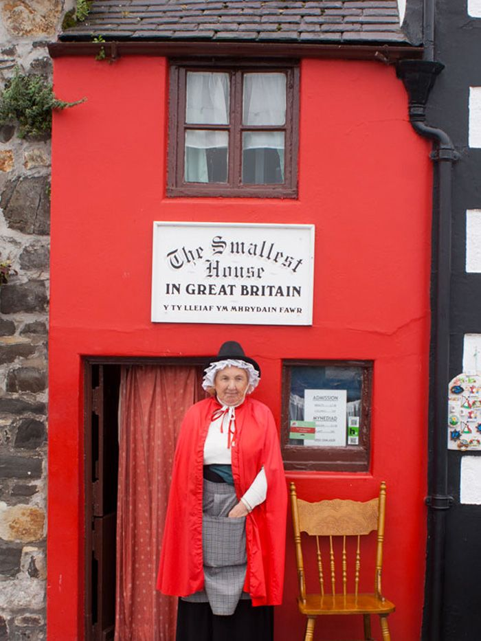 found in the quayside town of conwy wales the smallest house in the uk stands a mere in total