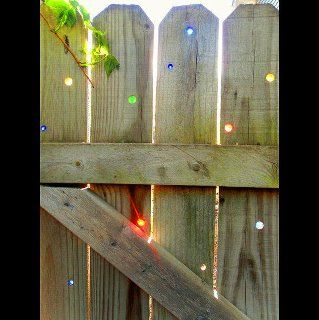 decorating old wood fence with marbels