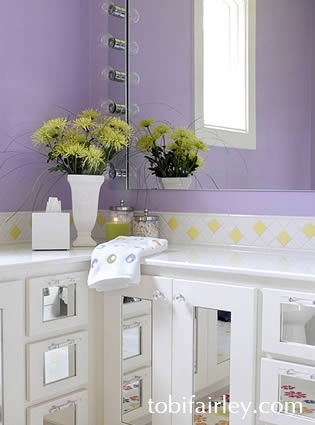 bathroom in purple with mirrored draw detail...designed by Tobi Fairley