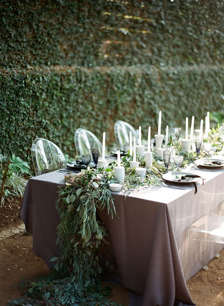 elegant garland centerpiece paired with modern details Photography: Clayton Austin - loveisabird.com  Read More: http://www.stylemepretty.com/2014/07/31/classic-black-and-white-wedding-inspiration/