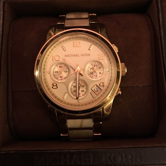 Michael Kors gold and light tortoise shell watch A wear everyday watch. The gold and tortoise shell combination is beautiful. Gently worn. Michael Kors Accessories Watches