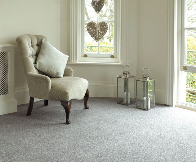 Grey carpet with cream walls.