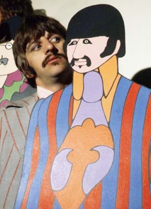 Ringo Starr with the Ringo Starr cut out board from the film Yellow Submarine:) (Ringo's face lol)