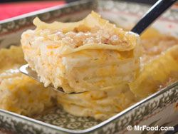 Pierogi Lasagna---Layers of Noodles, Seasoned Mashed Potatoes, Onions, Butter, Cheese.