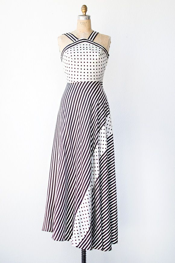 1970s - maxi dress made from a polka dot and striped polyester. This ...