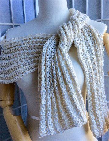 This elegant spring summer scarf/wrap makes a fabulous wrap for a bride and a romantic addition to your honeymoon wardrobe. This scarf adds a touch of class to anything you wear - wonderful with your favourite sweater, linen dress or with a summer tank and shorts , skirt or cropped pant.   Hand knitted with 2 yarns held together:   Yarn 1. Pure cotton   Yarn2. Cotton and silk   The 2 yarns together with the broken rib stitch create a soft drapey textile this scarf is one of a kind.   190...