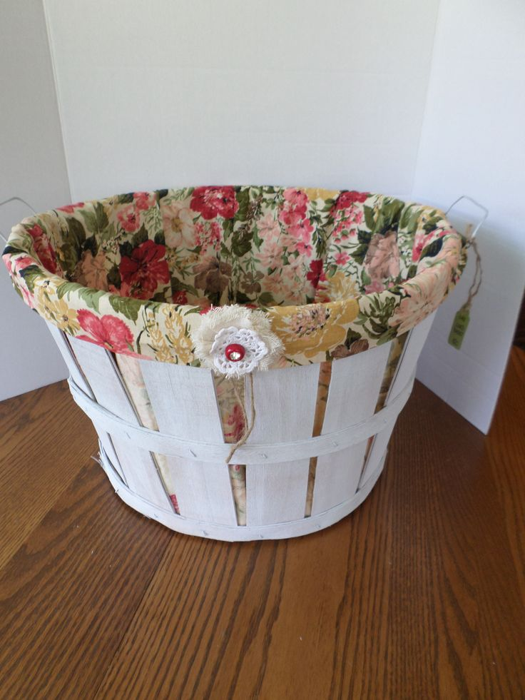 Bushel basket, painted and lined with vintage curtain fabric.