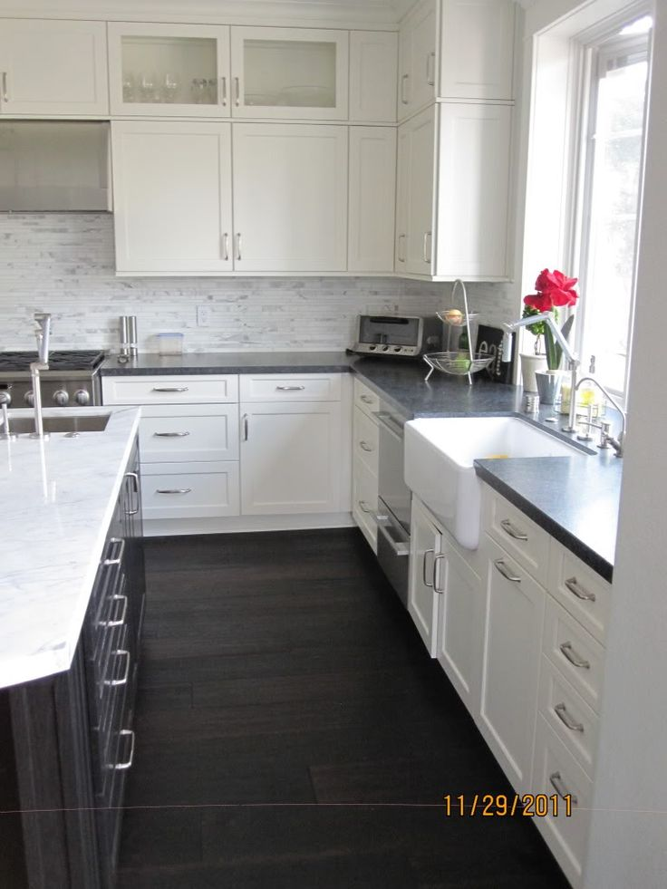 White cabinets with black granite, black cabinet, marble counter, gray