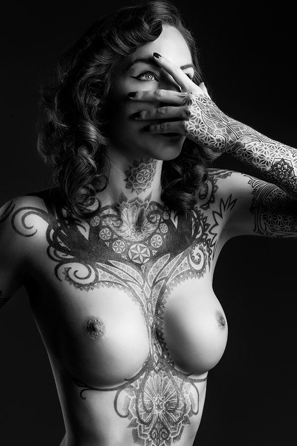 Chest tattoo. I love when they wrap around the edges. Either side, doesn't matter.