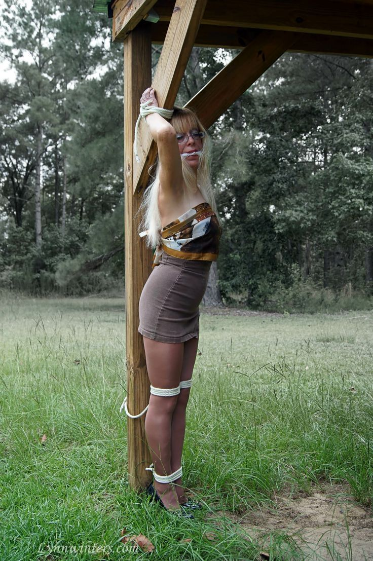 Outdoor bondage girl