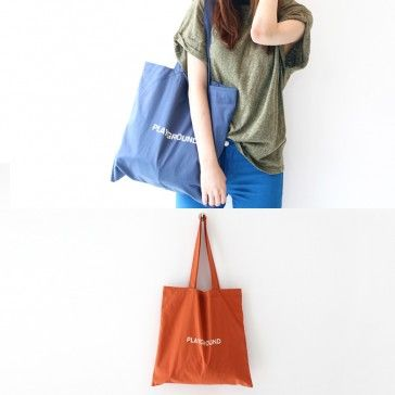"[Playground Bag] A fabric tote bag featuring a ""PLAYGROUND"" print. Essential item. Lightweight."