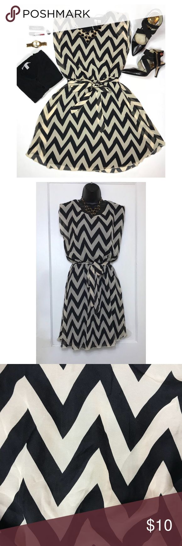 Chevron Print Dress Sleeveless dress features a bold chevron stripe throughout. Waist features elastic for a customized fit. Pull-on design. A-line skirt with straight hem that hits above the knee. Fully lined. Dresses