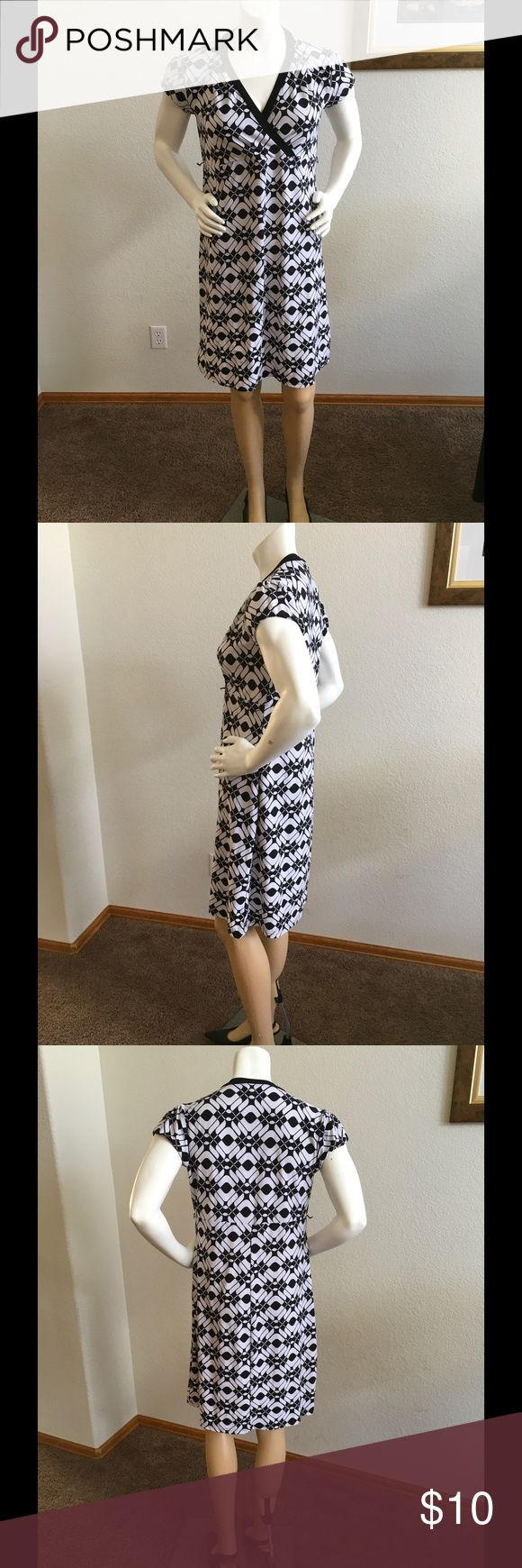 Black and white patterned maternity dress Maternity dress in black and white print. Short sleeve. Cross chest detail. Comfortable stretchy material. From Motherhood. Motherhood Dresses