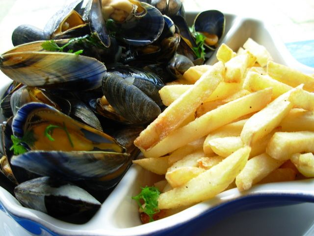 Moules Frites: They bring back Brussels.  They legitimize French Fries as a sophisticated side.  And I especially love them in a mariniere sauce.