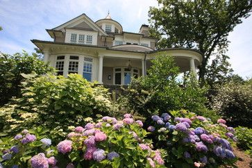 Stately Old House With an Abundance of Hydrangeas in View From the Front Porch. New York, Conte & Conte, LLC.