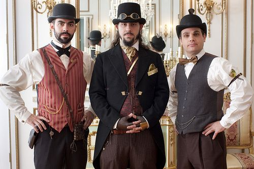 I can see him wearing something similar to this groom (guy in the middle). Plus I know he wants his best men dressed similarly, definately a waistcoat occasion!