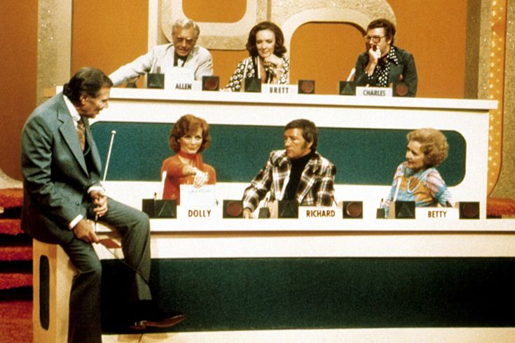Clockwise from top left: Allen Ludden, Brett Somers, Charles Nelson Reilly, Betty White, Richard Dawson, Dolly Read Martin, and Gene Rayburn in an episode of <em>Match Game,</em> 1970. From Everett Collection.