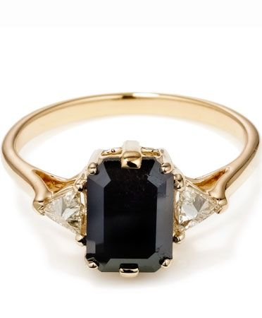 14kt yellow gold three stone ring features a stunning 1.48ct emerald cut black diamond with 1.70 ctw inverted set trillion diamonds on each side.  ANNA SHEFFIELD:BEA RING $4500.00
