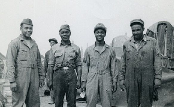 """An image of the African American members of the US Army Corps of Engineers that worked on the Alaska-Canada Highway Project. Some say there achievements were as great as the """"Buffalo Soldiers"""" and """"Tuskegee Airmen"""". Their success went a long way towards desegregating the military."""