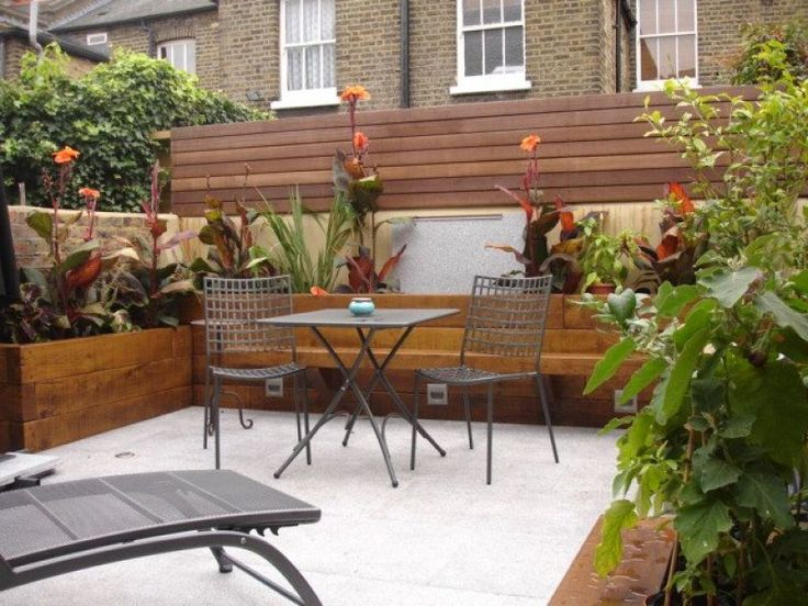 fionas beautiful courtyard garden with new oiled railway sleepers